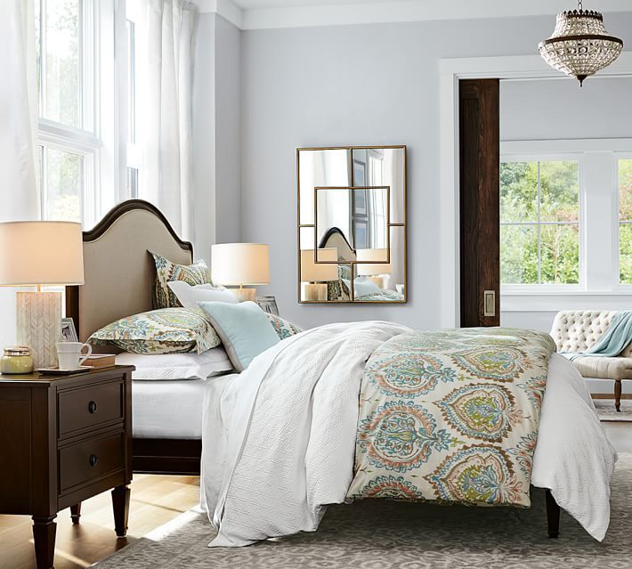 Embellishments like a paneled frame, tapered feet and a generous, curved headboard make it a timeless addition to your bedroom decor.
