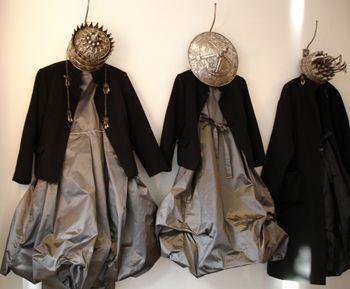 """Display. Egg Store London. Brainchild of Maureen Doherty who mixes luxurious pewter-coloured taffeta dresses with Silver Miao (miautso) headresses, a tribe from south west China...(photo and description, Nathalie Hambro, My London Blog """"The Blog That Kills Boredom')"""