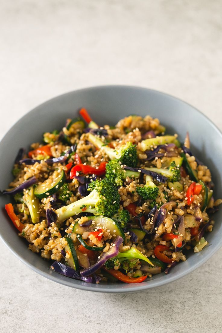I make this brown rice stir-fry with vegetables every week. This recipe is life-changing and so simple. Add your favorite veggies or what's in season.