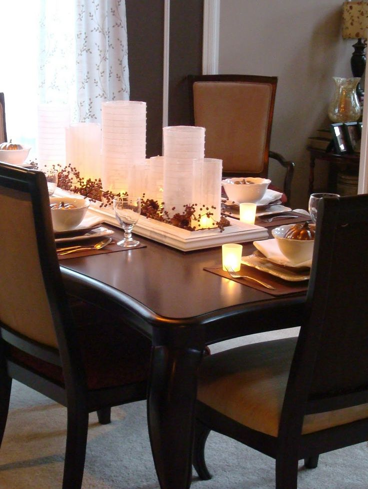 16 Thanksgiving Table Ideas | Thrifty Decor Chick (use what you have - a platter would work, too ... could change out floral decor seasonally ... love the look on the dark table)