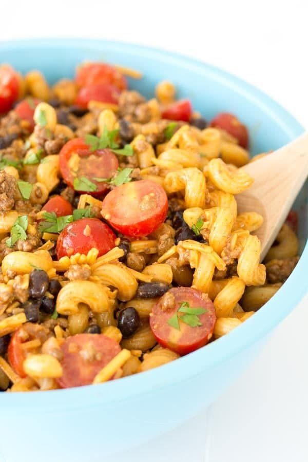 If you love taco salad then this taco pasta salad is for you! It's loaded up with ground beef, juicy tomatoes, black beans and lots of cheese!