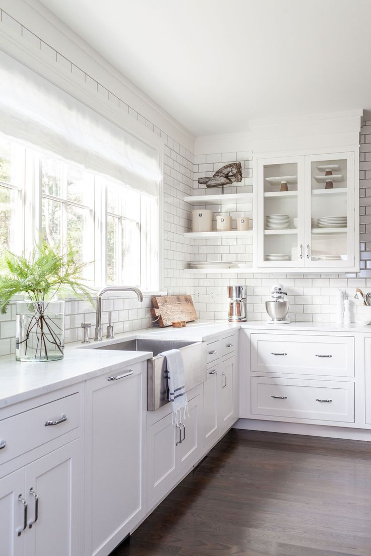 Amazing kitchen design idea with white tile, white cabinets, large window with white blinds and open kitchen shelves