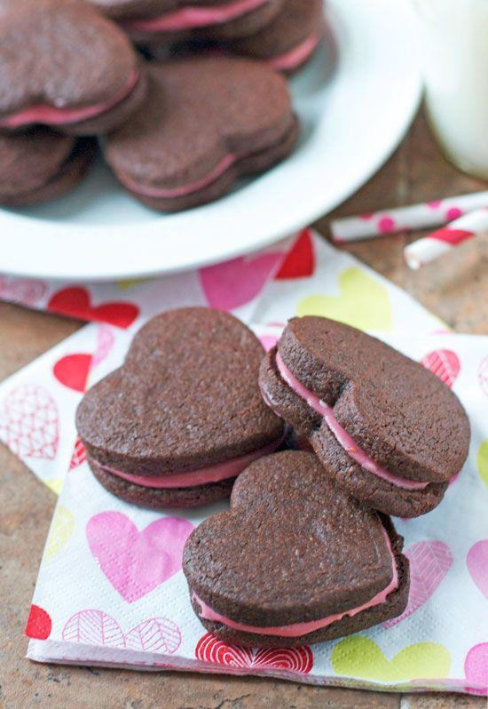 Dark Chocolate Heart Sandwich Cookies with Raspberry Cream Cheese Frosting.