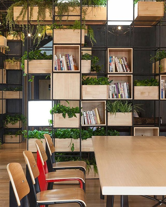 Beijing's recent challenges with air pollution inspired Penda to conceive a living, breathing space for a local cafe to call home. Repurposed steel shelves, painted black and formed into modular cubic storage systems, define the cafe's interior and provide nearly limitless design flexibility. A wide assortment of books and small vegetation line the shelves, setting a comfortable, relaxing, and intellectually stimulating atmosphere. #architecture #interiors #design #interiordesign #china…
