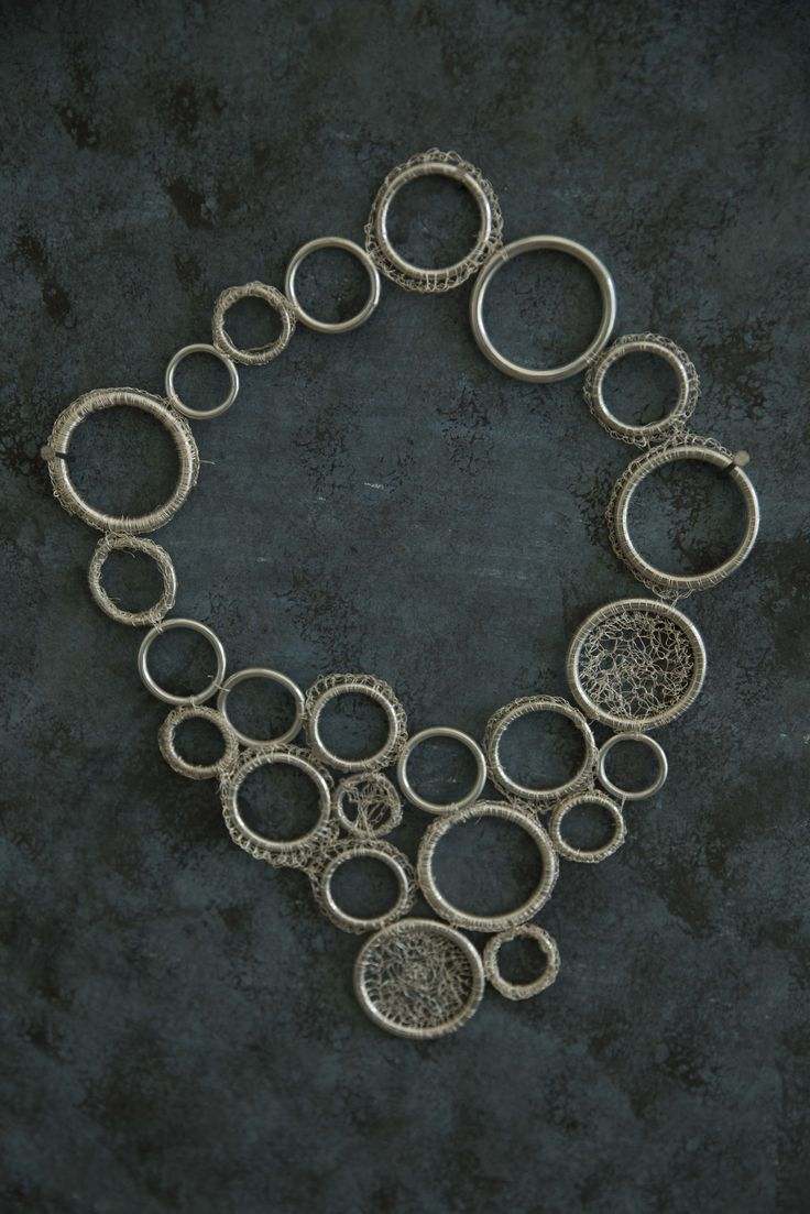 Steel rings and crocheted wire neckpiece.