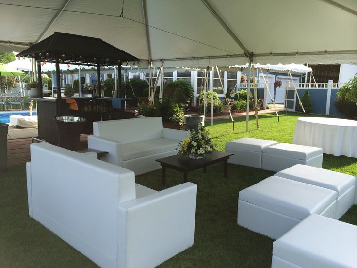 Outside white lounge chairs and ottoman