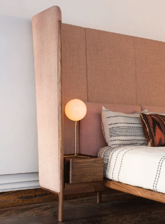 Tall wrap around headboard and integrated bedside table