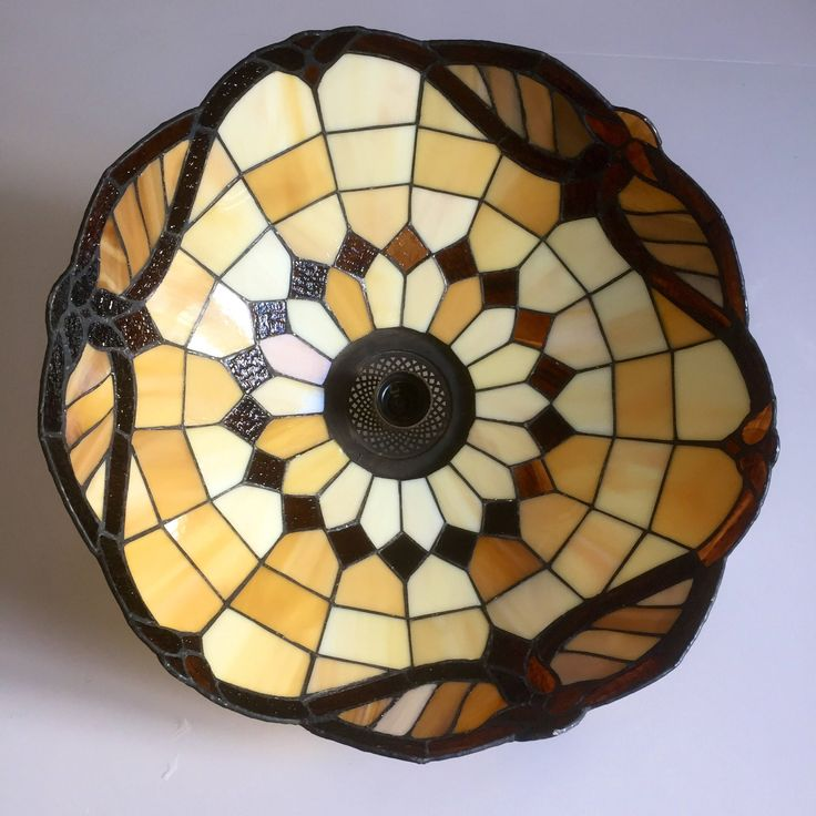 A personal favorite from my Etsy shop https://www.etsy.com/ca/listing/552532701/victoriantiffinystylestained-glasslamp