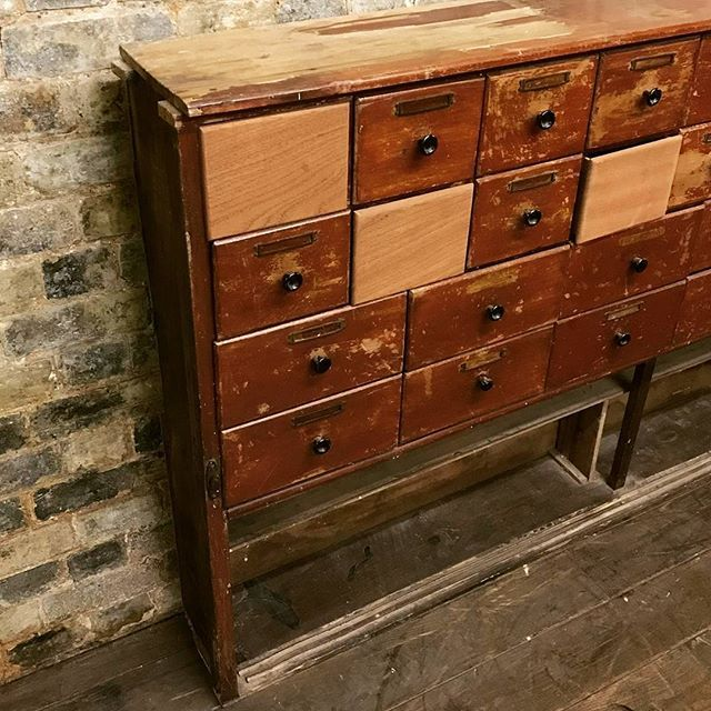 Antique Chemist Shop Drawers at D and A Binder | We have gorgeous antique pharmacy chests of drawers at Binder's! This lovely orange/red set of chest of medical drawers has plenty of character and is going to be stunning for set design or to add vintage style to any office or retail setting! Email us at david@dandabinder.co.uk or take a look at more images at DandABinder.co.uk.  #shopcounter #antiquecounter #vintagecounter #Victorianshopfitting #Antiqueshopdrawers #pharmacydrawers…