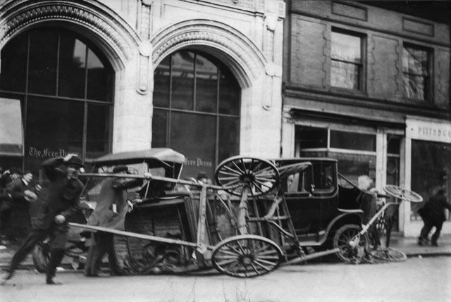 Carts are blown over in front of the Detroit Free Press building. The first warning of the 1913 storm was a small notice in The Detroit News. On Nov. 6, 1913, the newspaper's weather forecast announced moderate to brisk winds for the lakes. (Detroit News Archives)