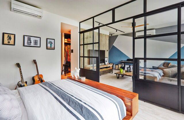 Open concept bedroom with living room