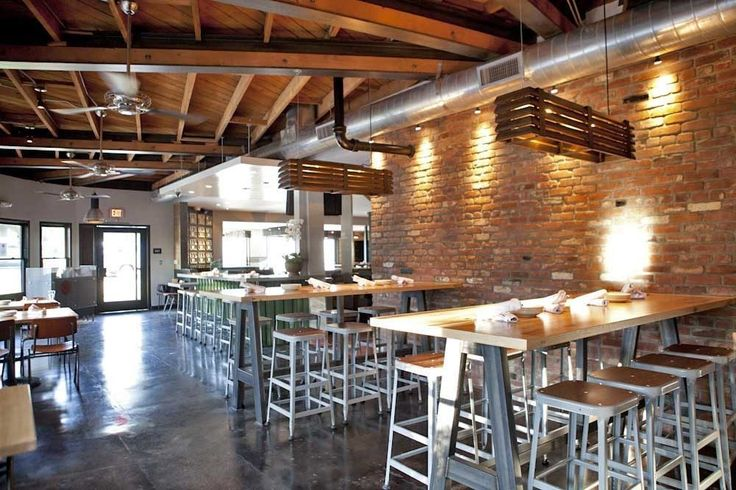 Exposed brick light wood cement floors and metal