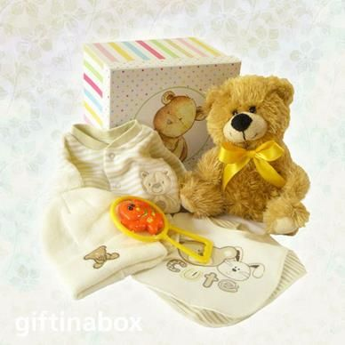 """A gorgeous baby hamper made up of a selection of beautiful baby products in a """"teddy bear"""" theme. Little """"bear hugs"""" for the new addition!   Soft, cuddly teddy bear Teddy bear beanie Teddy bear baby growth Teddy bear baby rattle Teddy bear bib"""
