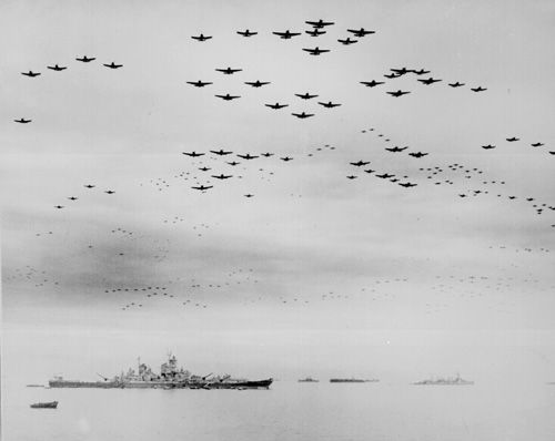 In a thunderous display of aerial might, hundreds of US Navy Corsairs and Hellcats fly over the Missouri immediately after the surrender ceremony, underscoring the power of the victors over the vanquished. (National Archives)