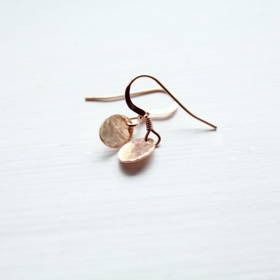 Dainty earrings composed of TINY hand-hammered rose gold filled* oval discs and rose gold filled ear wires. * Gold fill is a thick layer of real gold bonded onto a base metal. The quality is significantly higher than gold plate. With good care it will not chip or tarnish. The discs are tiny (approx 8x6mm) and thin, making them lightweight. Hammering is done by hand in a slightly rustic style; expect variations. Each pair is made to order. total earring length - 21mm/0.82 inch  Dainty, ev...