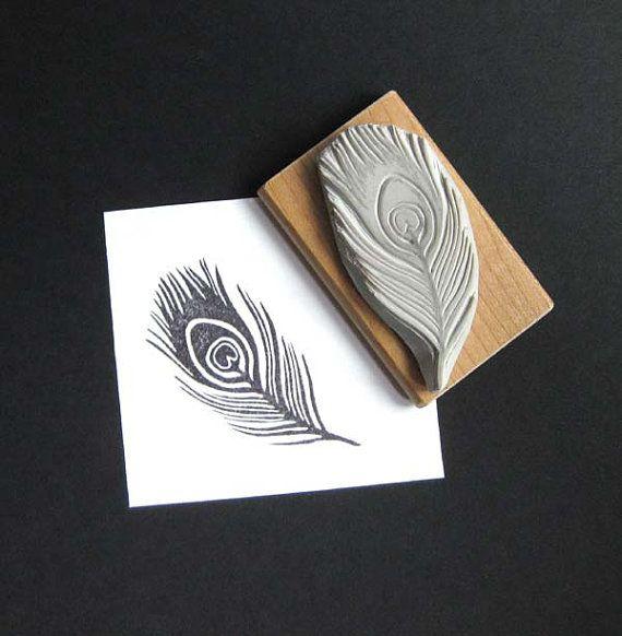 Talladas a mano de pluma de pavo real de sello