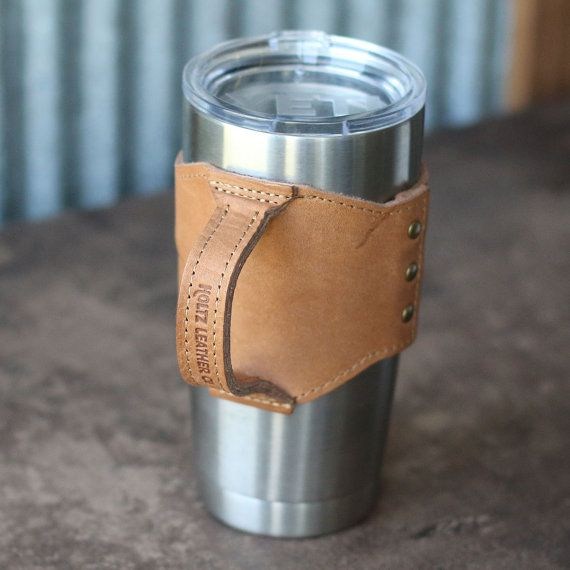 The Rocket City Yeti Personalized Leather Drink Cooler Wrap with Handle for YETI Rambler Tumbler Tumblers - Yeti Handle  Carry your Yeti Tumbler in style with our Rocket City Yeti Wrap with Handle! It is handmade right here in our shop with the finest of Full Grain American leathers. We hand-pick our leather hides from a local tannery for a rustic look and feel. This is a gift that will be used and loved for a lifetime!  This wrap is inspired by our home city of Huntsville, AL, which is…