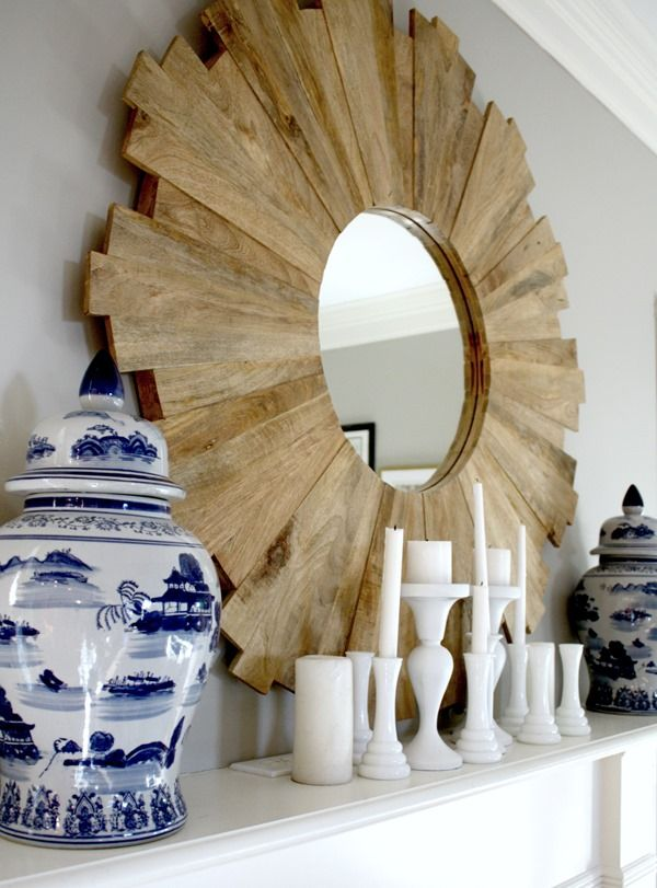 Our January Living Room - Emily A. Clark  -  wood sunburst mirror with blue and white ginger jars