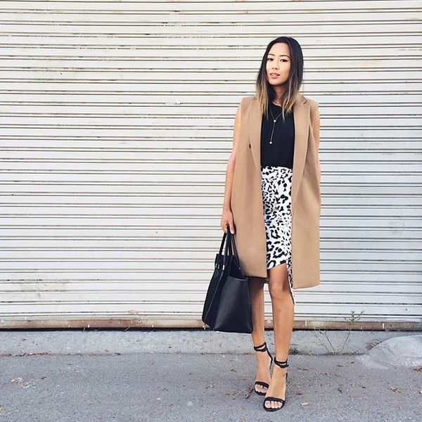Aimee Song from Song of Style mixes prints and neutrals with a leopard print skirt and memento vest.