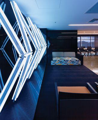 Jonathan Jones' lighting installation inside the Cue Clothing Co. HQ in Sydney. Interior design by Geyer