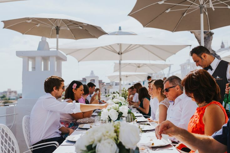How luscious and gorgeous do these beautiful silk flowers look for this amazing wedding breakfast on the roof top terrace of Don Ferrante, Monopoli, Italy. Photo by Benjamin Stuart Photography #weddingphotography #weddingbreakfast #silkflowers #tabledecor #receptiondecor #donferrante #italianwedding