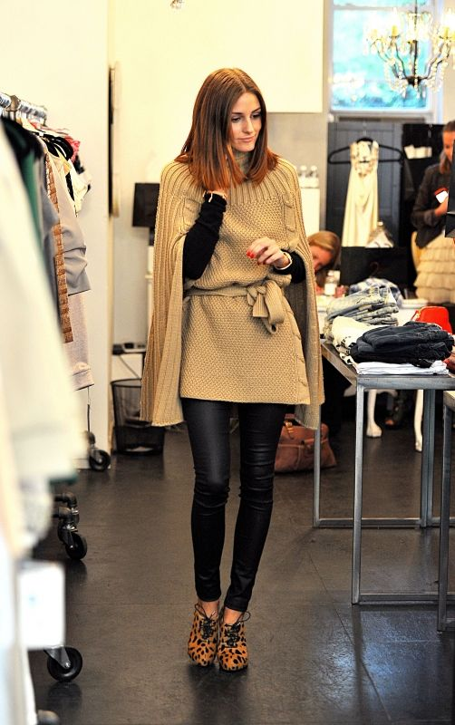 Olivia Palermo wearing Members Only Liquid Leggings in Black and Charlotte Olympia Alice Leopard Print Booties.