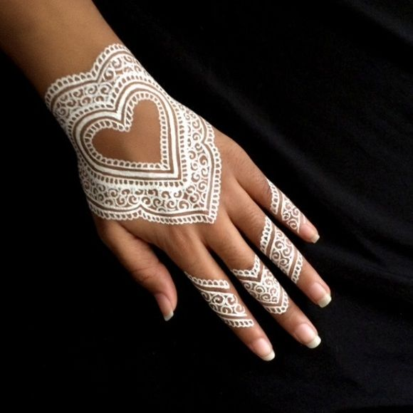 White henna tube- last one This listing is for one tube of white henna. White henna does not stain the skin like other henna. It just sits on top of the skin like makeup after it has dried. Very cool for special occasions or festivals. One tube is enough for several applications Makeup