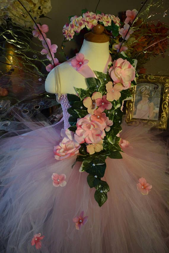 Exquisite deluxe water fairy tutu dress. Colors: Teal Purple Lime green Lavender Handmade satin/fabric flowers with iridescent rhinestones. Long Tail in the back Satin ribbon straps tie in the back of dress. Fairy wings sold separately If you purchase one of my fairy dresses you can