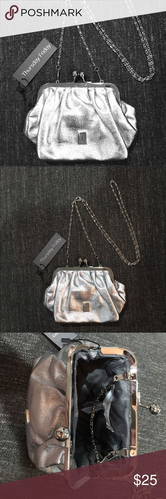 Silver Kisslock Clutch from Thursday Friday! 🌺 This is an adorable and roomy little bag. It features a detachable silver strap, so we can be carried as a purse or as a clutch. Pretty silver, and fully lined. The tags are attached Thursday Friday Bags Mini Bags