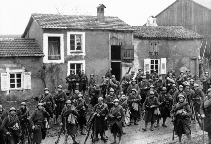 While German forces were concentrated on Poland, anxiety was rising on the Western Front, with French troops welcoming British soldiers as they deployed along the border with Germany. Here, French troops pose in a cantonment in France on December 18, 1939.