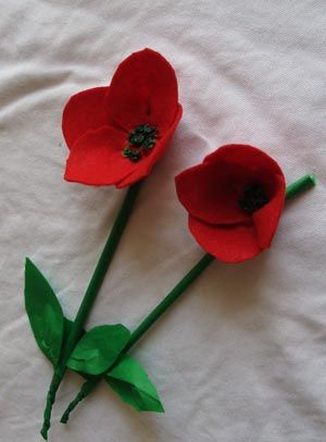 Handmade poppies made with felt and straws