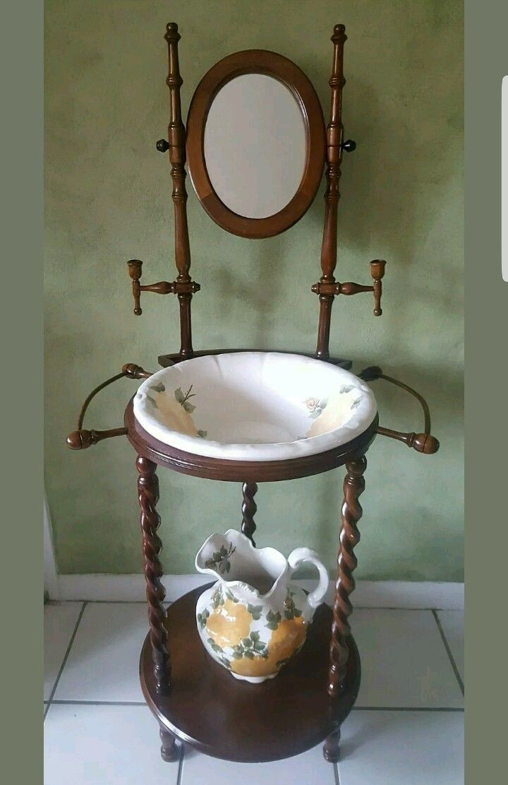 Finally, I own one...#luvnlyfe! Antique Cash Family 1945 pottery wash basin and pitcher made in Edwin Tennessee with wood stand. Has yellow roses motif.