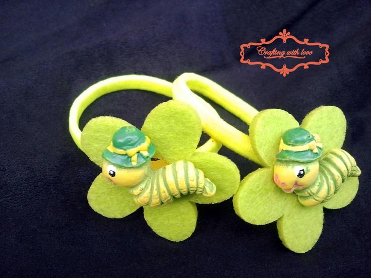 Handmade caterpillar felt ponytail holder.