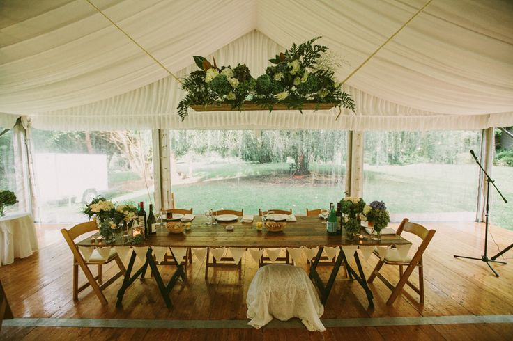 silk lining, 10m marquee, clear walls, integrated timber flooring, vintage tables, wooden padded folding chairs, south coast weddings, south coast party hire