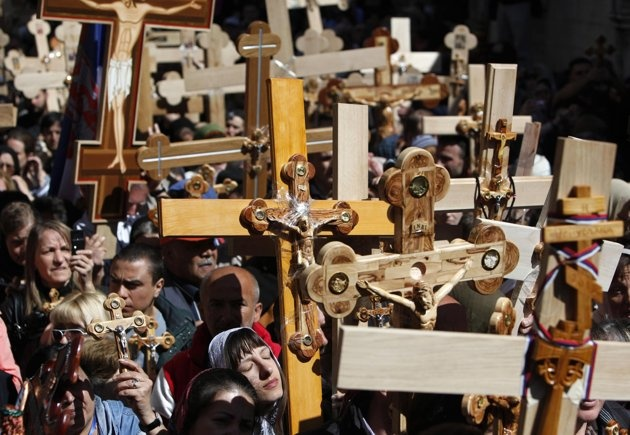 Christian worshippers carry crosses as they take part in the Eastern and Orthodox Church's Good Friday procession in the Old City of Jerusalem April 13, 2012.