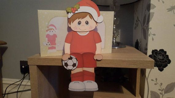 Check out this item in my Etsy shop https://www.etsy.com/uk/listing/475677080/boy-footballer-in-red-kit-christmas-card