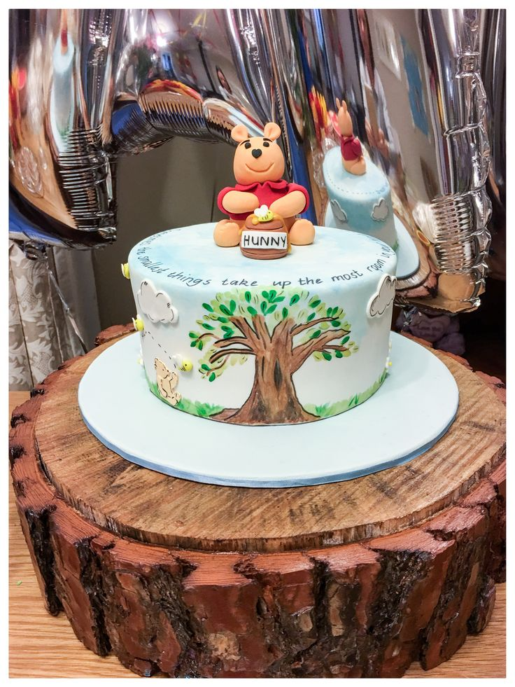 Hand painted Winnie the Pooh baby shower cake