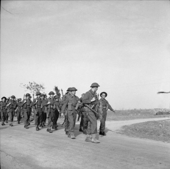 Men of the Royal Air Force Regiment marching inland from the Operation TORCH landing area on the coast of Algeria, to take possession of Maison Blanche airfield.