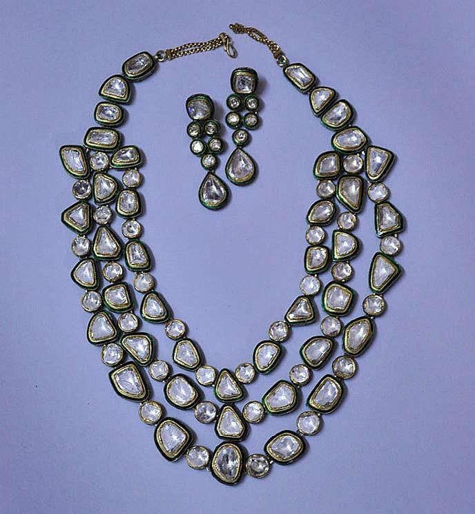 A suite of Indian Polki un-cut Diamonds Jewellery, comprising a necklace of closely connected with polkis un-cut diamonds set in kundan 24 cts gold, surrounded by green enamel, with a pair of similar design earrings