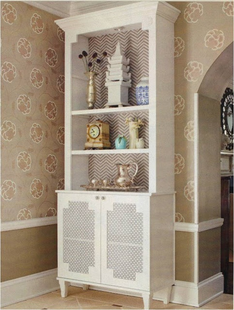 Hide the Air Vent: There is a large return air vent behind this cabinet. The cabinet was painted, wallpaper added on the top shelf part and the bottom of the back  is cut out, and with doors covered in decorative metal mesh you can get at Home Depot or Lowes. the sister sophisticate blog