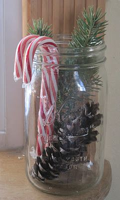 Mason jar with pinecone, greenery and candy canes ... Cheap, EASY, but still Very Sweet and Homey <3