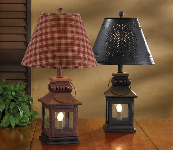 """These Primitive Lamps made of Iron add that Rustic Appeal! These will stand out on any stand! 3 way switch featuring a night light. (60 and 6 watt) Your choice of Black or Red Dimensions: 20""""H x 5.5""""S"""