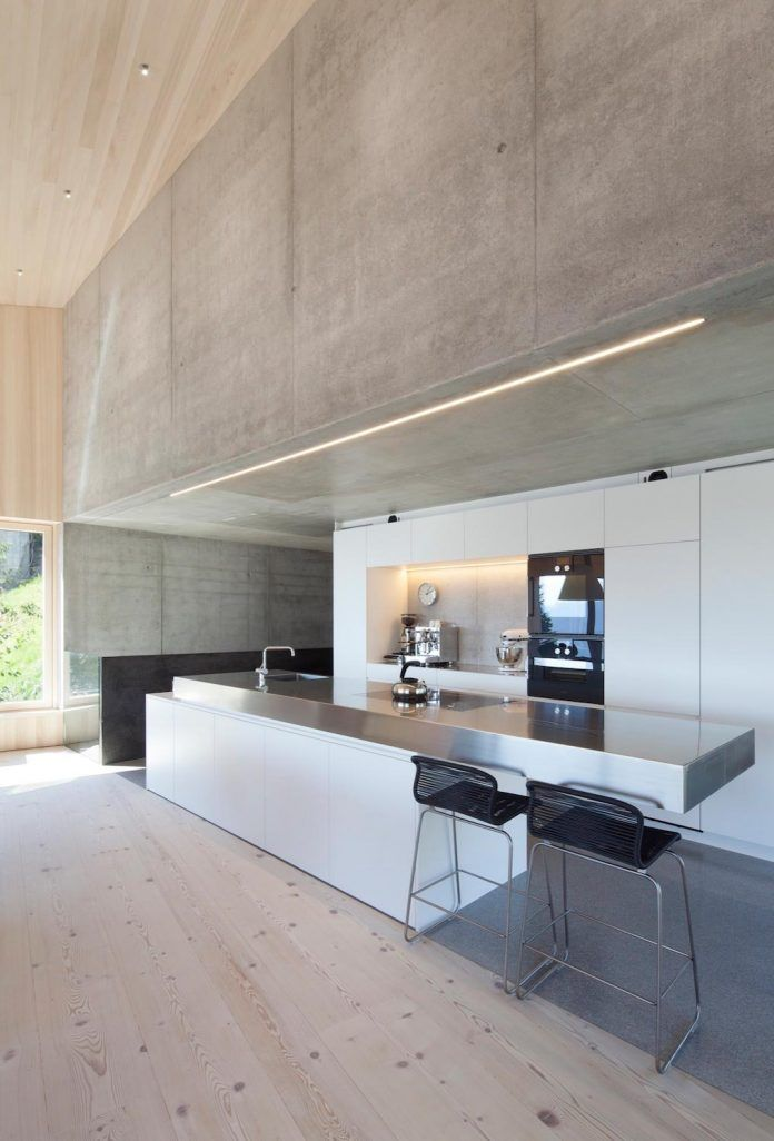 House Built On An Extremely Steep Piece Of Land With Forrest Views From All  The Interior