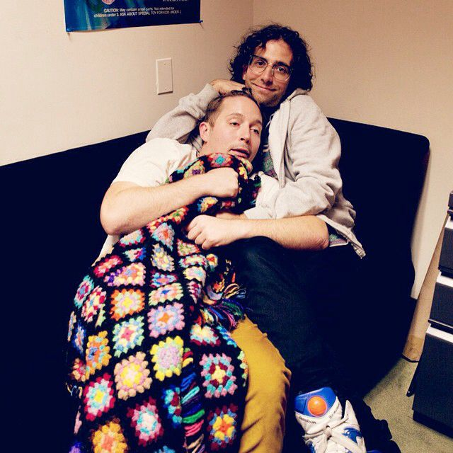 Beck Bennett and Kyle Mooney snuggling.