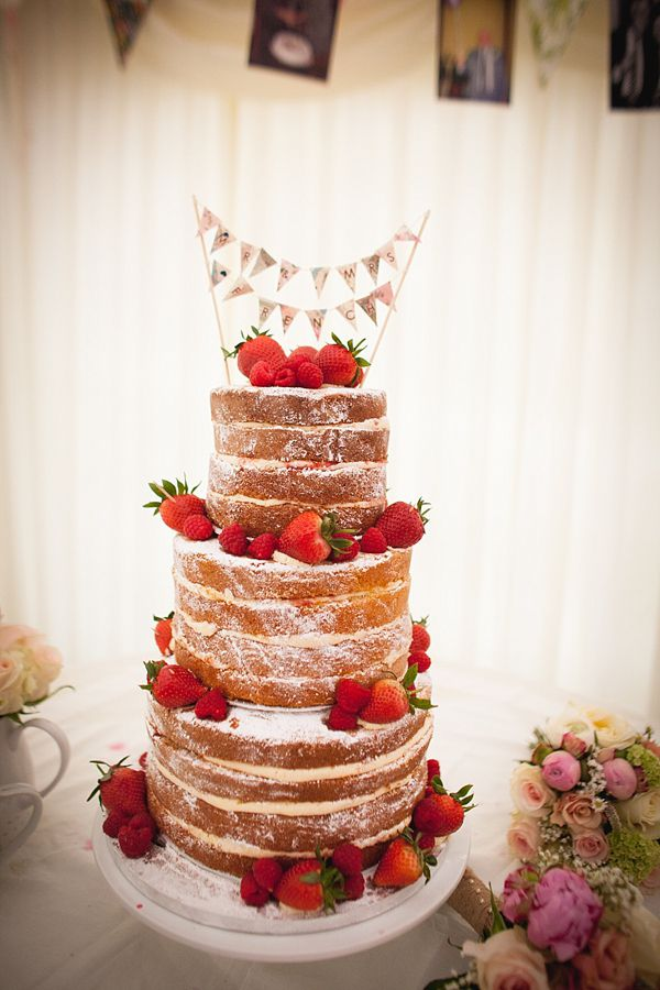 Victoria sponge wedding cake with strawberries. Photography by mariewoottonphotography.co.uk