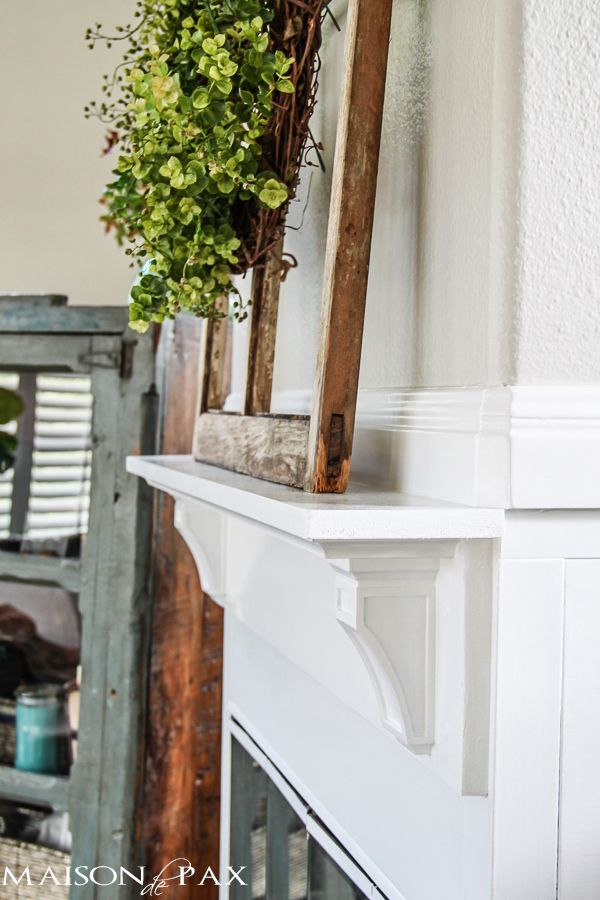 I love how this simple diy mantel changes the fireplace! Find out how to build a simple fireplace mantel (or faux fireplace shelf!) with this easy to follow tutorial | maisondepax.com