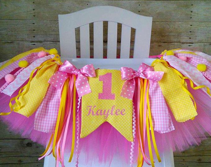 Our strawberry picnic high chair banner is super cute for any little ones birthday party! Its 35 inches long and fits standard high chair trays. Made with coordinating fabrics, poms, and a ruffled banner. All of our high chair tutus come with hook and loop fasteners attached so you can easily attach it to your high chair Can be made in any color to fit with your childs party theme! When ordering please let us know if you would like a different color scheme - If no note is left it will be ...