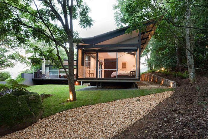 Foxground House by Louise Nettleton Architects sits lightly on the site with a roof line that promises flight. Corrugated steel is the material of choice referencing the Australian history of the corrugated iron shed in the bush. Indoor and outdoor meet seamlessly in this stylish contemporary home.