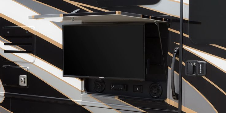 Exterior entertainment centerBask in the outdoors with the help of a Furrion® AM/FM/CD/DVD player, two speakers and a 39-inch LED TV built and tested especially for motorhomes.