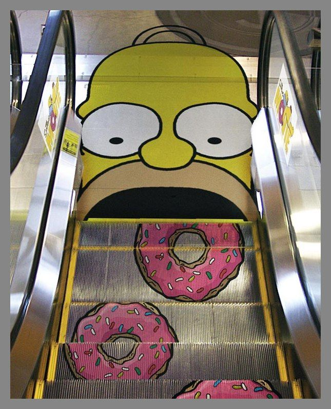 Advertising The Simpsons through this giant Homer at the end of the escalator. Very creative.